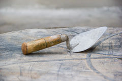 Old used metal masonry trowel Stock Image