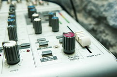 Old used musical mixer closeup Royalty Free Stock Images