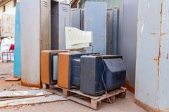Old, used and obsolete TV and PC monitor with cathode technology. Piled up several retro, old vintage TV and one PC display, they are ready for recycling stock image