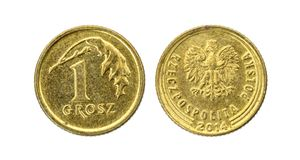 Old used one Polish grosz coin isolated on white background. royalty free stock photos