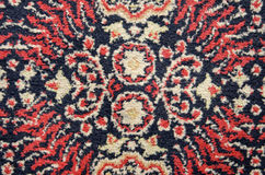Old used ornamental carpet background Stock Images