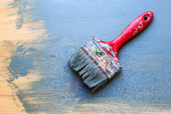 Old used paint brush on partial paint wood background. Diagonal Royalty Free Stock Photography