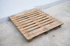 Old used pallet on the floor Royalty Free Stock Photo