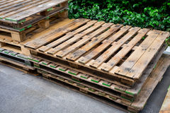 Old used pallets stacking together. In factory Stock Image