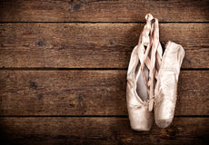 Old used pink ballet shoes hanging Stock Image