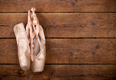Old used pink ballet shoes hanging Stock Photography