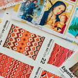 Old used postage printed stamps from various countries and different time, texture of paper Stock Photo