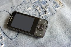 Old Used retro cell mobile phone. On fabric stock photo
