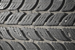Old used second hand black car tyre texture motif pattern. Old used second hand black car tyre texture Royalty Free Stock Images