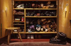 Old Shoes in Closet. Old used shoes in old closet, lifestyle details stock photography