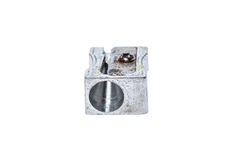 Old used silver metallic steel pencil sharpener isolated on whit Stock Photography