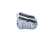 Old used silver metallic steel pencil sharpener isolated on whit Royalty Free Stock Image