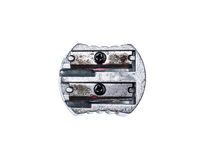 Old used silver metallic steel pencil sharpener isolated on whit Stock Photo