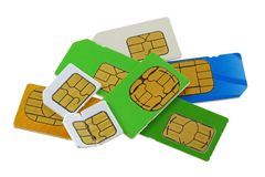 Old and used SIM cards. A group of old and used Subscriber Identity Module (SIM) cards, one is bent and broken stock image