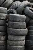 Old used stacked tires. Vertical background Royalty Free Stock Images