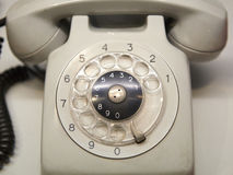 Old used telephone with rotary dial Royalty Free Stock Photography
