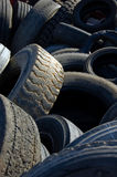 Old used tires in garbage. Old car and truck tires on garbage pile Stock Photos