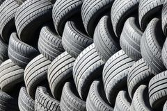 Old used tires that are lined up in a pile royalty free stock image