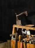 Old used tools in the toolbox. Dark background. spot lighting. Wooden box. Royalty Free Stock Image