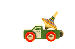 Old used truck car toy with colorful whirligig. Isolated on white Stock Image