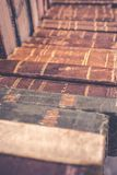 Old used vintage books with colorful leather covers lay on market in Italy. Close up. royalty free stock photography
