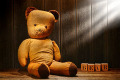 Old and Used Vintage Teddy Toy Bear in Aged Attic royalty free stock photography