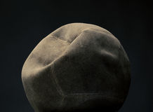 Old and used volley ball. Old vintage volley ball on a dark background Royalty Free Stock Image