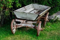 Old and used wagon standing near bushes Royalty Free Stock Images
