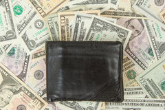 Old used wallet with dollars Stock Images
