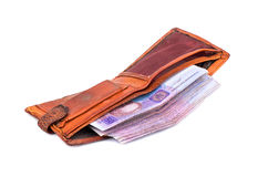Old used wallet. Open old shabby wallet filled with Ukrainian money on a white background stock photo