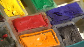 Old used watercolor paints. Colorful view of an old watercolor paints box stock footage