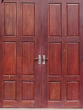 Old used weathered abandoned red brown colour hard wood double door Royalty Free Stock Photos