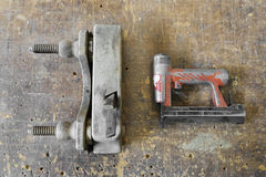 Old used wooden planer and red air nailer or nail gun carpenter. Old used wooden planer and red air nailer or nail gun, carpenter tools Royalty Free Stock Photos