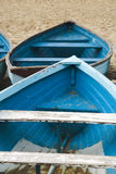 Old used wooden row boat on a sandy beach sand Royalty Free Stock Photo
