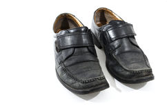 Old used and worn black leather shoes Stock Images