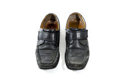 Old used and worn black leather shoes Royalty Free Stock Images