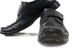 Old used and worn black leather shoes Royalty Free Stock Photos