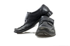 Old used and worn black leather shoes Stock Photography