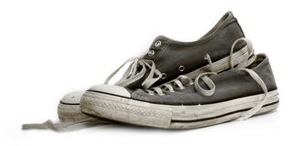 Old used and worn out sneakers or trainers Royalty Free Stock Photography