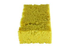 Old used yellow sponge on white background Stock Images