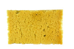 Old used yellow sponge on white background Royalty Free Stock Images