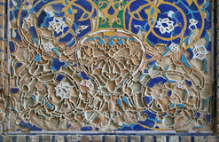 Old Uzbek mosaic. Piece of the old mosaic on the wall of an ancient building of Registan square, Samarkand, Uzbekistan Stock Photos
