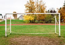 Old vacant football soccer goal gate in rural grass field. Stock Photos
