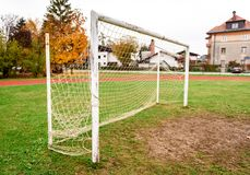 Old vacant football soccer goal gate in rural grass field. Royalty Free Stock Photos