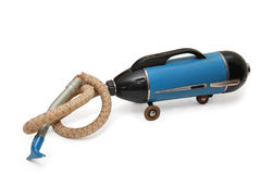 Old Vacuum Cleaner. On a white background stock photos