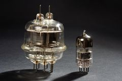 Old vacuum tube on black Royalty Free Stock Photography