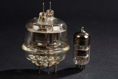 old vacuum tube on black Stock Images