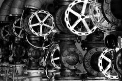 Old valces. Contrasty industrial view with old valves Royalty Free Stock Photos