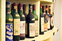 Old valuable collection of italian wine bottles stock photography