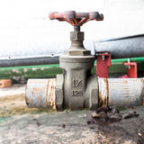 Old valve mounted on rooftop industry building Royalty Free Stock Photography
